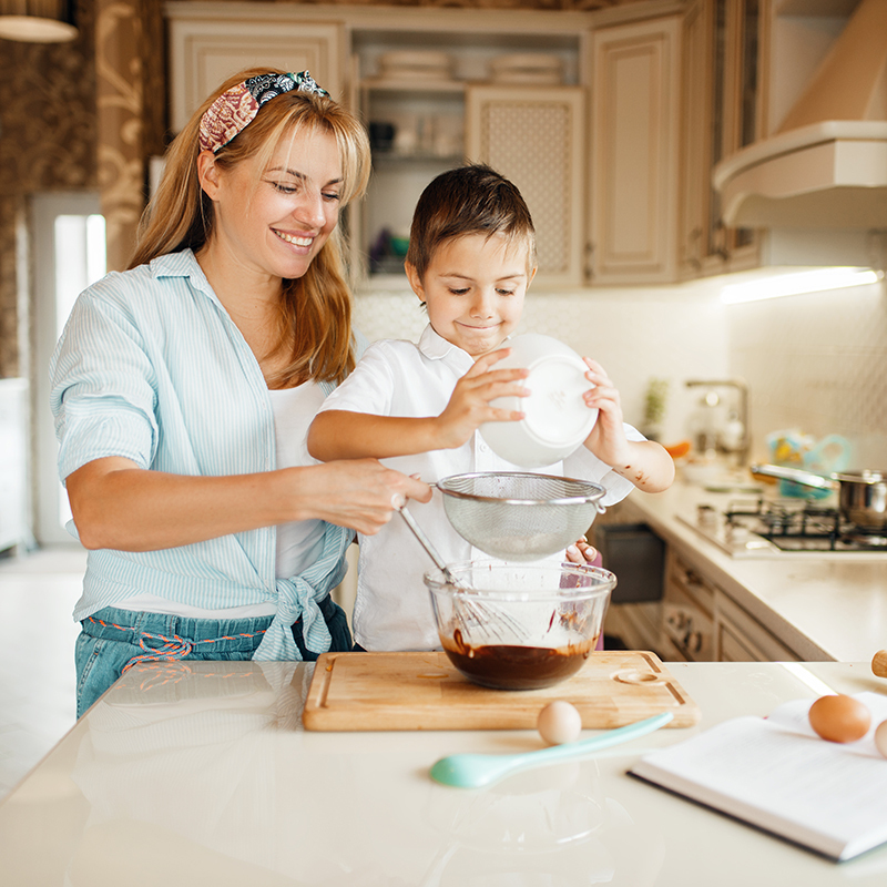 This image has an empty alt attribute; its file name is mother-with-son-mixing-melted-chocolate-bowl.jpg